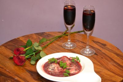 Heart shaped Raviolli with ricotta cheese and beetroot, in beetroot sauce