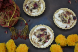 Thandai cream cheese tart with Pistachio crumble and Gulukand